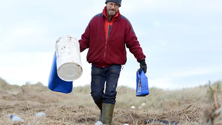 Staff and volunteers at RSPB Titchwell clean up parts of the beach and the reserve after the floods