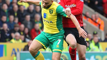 Norwich City have offered half-price admission for the club's Premier League trip to Cardiff next mo