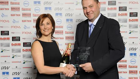 David Cunliffe, managing director of DC Electronics, receiving the Small Business of the Year trophy