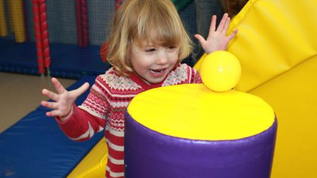 Two-year-old Imogen Atkinson having fun in the Lighthouse Community Church soft play area. Photo: Ka