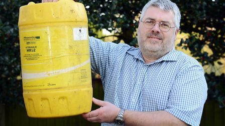 Tim Birt with the 25 litre plastic container which he was refused permission to leave at the recycli
