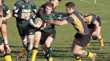 North Walsham's Will Quinn is crowded out by Welwyn Garden City players during last week's clash. Pi