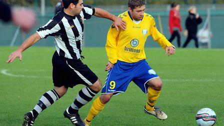 Lynn, yellow, beat Acle 3-0 the last time the two sides met in Norfolk's premier cup competition. Pi