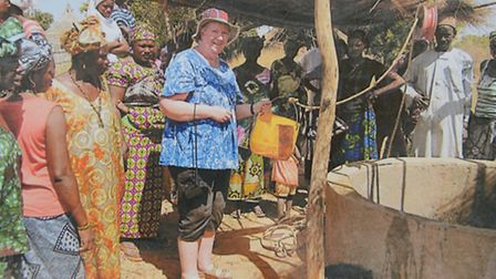 Charity founder Janet Clark is pictured at the well in Gambia which has been funded by Liz Hunton an