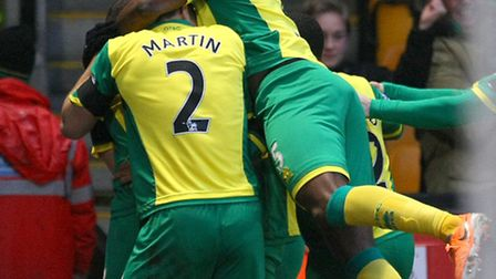 Robert Snodgrass is mobbed by Norwich City team mates after his winner against Tottenham at Carrow R