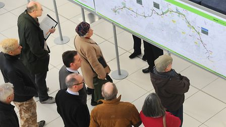 Members of the public study the latest plans for the NDR, on display at the Forum. Picture: Denise B