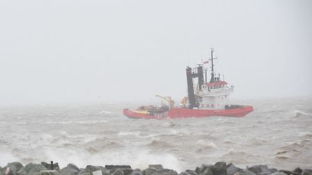 Stormy weather batters the east coast.One boat battles it's way into Lowestoft harbour.
