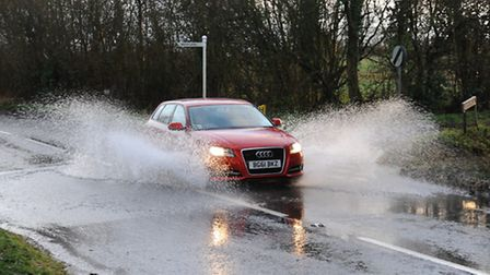 Cars driving through water on the B1077 Shelfanger and Winfarthing