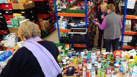 Volunteers working hard to help at the Norwich Foodbank at Henderson Business Park.PHOTO BY SIMON FI