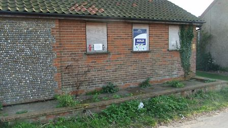 the toilet block before its new life as a cottage