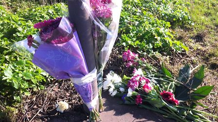 Flowers and tributes left at the scene of a fatal collison on the A146 in Stockton on Saturday.