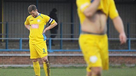 Lynn skipper Ryan Clarke, back, and Andy Hall, at the final whistle. Picture: Ian Burt