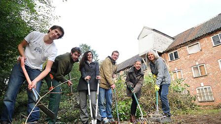 Residents during an earlier tidy up of the land at the centre of the Aylsham Mill saga PHOTO: ANTO