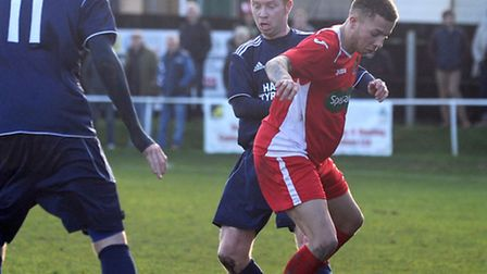 Tom James, right, holds off Hadleigh goalscorer Shane Wardley. Picture: Phil Morley.