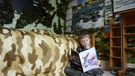 Samuel Boore (6) has turned his bedroom into a military museum. Picture: Ian Burt