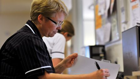 Liz Hogbin, head of compliance governance, checking medical records at the N&N. Photo: Bill Smith