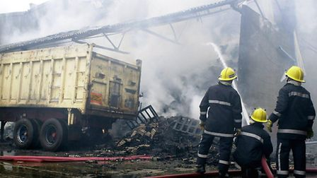(1of14) Fire crew attend the blaze at Omni-Pac factory, Gt Yarmouth. edp 24/7/02
