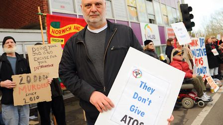 Mark Harrison, chief executive of Equal Lives, with other protesters outside the Atos assessment cen