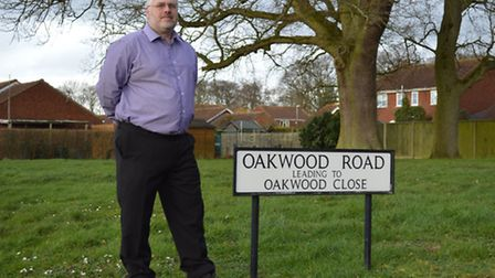 Dereham town councillor Tim Birt at the public green space on Oakwood Road