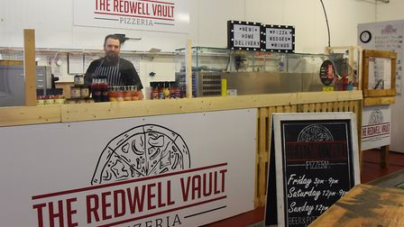Chef Richard Ellis creating the stonebaked artisan chef baked pizzas at the Redwell Vault Pizzeria.