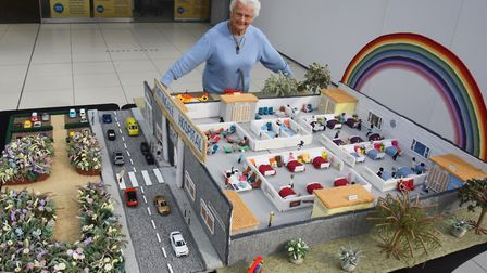 Margaret Seaman, 91, with her latest knitted creation, Knittingale Hospital, to raise money for Norf