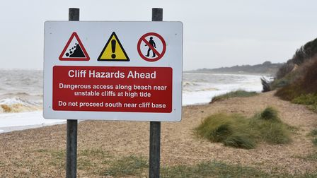 Warning signs urge people to stay safe on the coast and near the eroding cliffs at Pakefield. Pictur