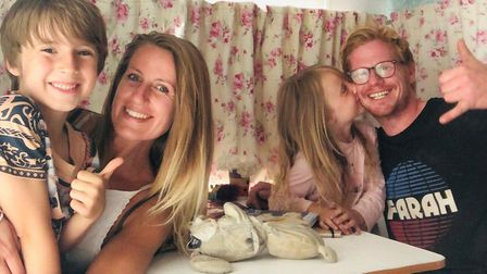 Francesca and Joey (left), with Francesca's two children Finlay (7) and Imogen (5) as they sit in th