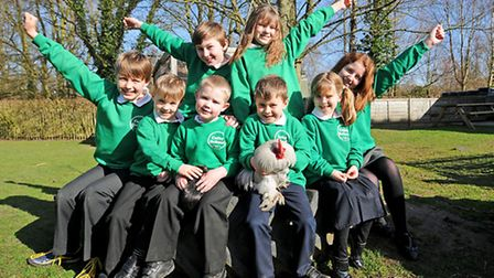 Colby School pupils receive a Diana Award for their Buddies scheme. Older pupils, back left to right