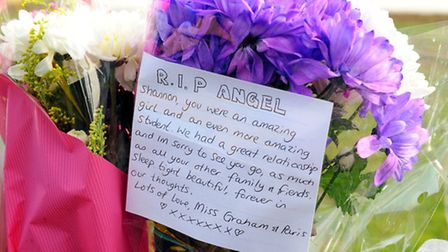 <Monday morning> Flowers and tributes left at the scene of a fatal collison between a bus and a teen