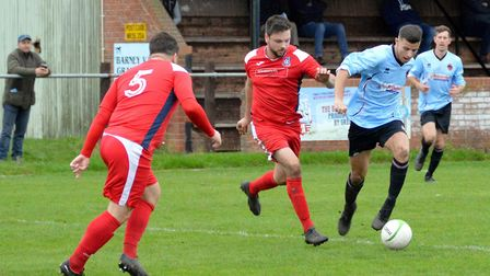 Bungay player Luke Ellis on the ball during their home defeat. Picture: Shaun Cole