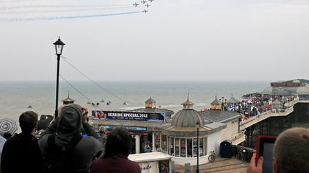 The Red Arrows fly over Cromer Pier during their last appearance at the resort in 2012 PHOTO: ANTO