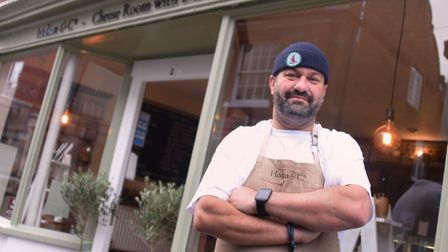 Chef Charlie Hodson stands outside his delicatessen and cheese room in Aylsham.