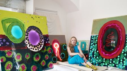 Norwich based artist Zheni Warner with some of her work. Picture: Tony Warner
