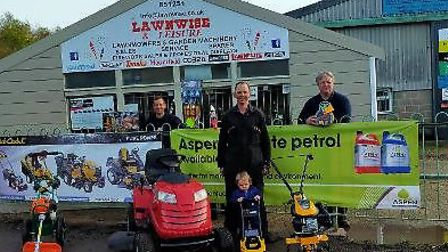 Outside Lawnwise and Leisure Hempton Road with a small selection of machinery and fireworks. John L