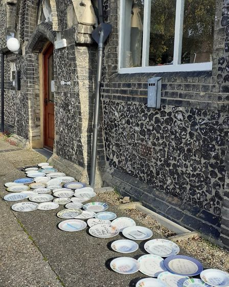 Empty plates left outside the Conservative headquarters in Norwich in support of Marcus Rashford's s