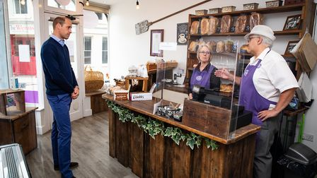 The Duke of Cambridge speaks to owners Paul and Teresa Brandon during a visit to Smiths the Bakers,