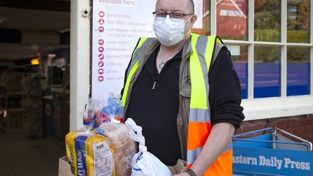 Mark Rischmiller delivers from the Coltishall Post Office and Mace to those who are sheltering in th