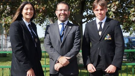 Neyah Laroiya and Campbell Pick with Springwood High School executive head Andy Johnson Picture: Sp