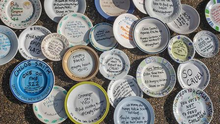 Empty plates were left outside a political office as part of a protest over an MP's vote not to exte