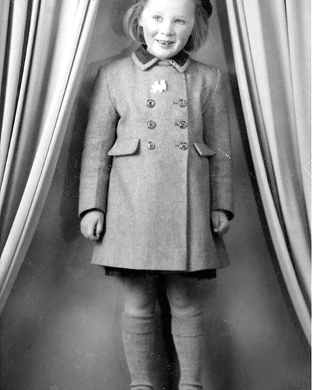 Young Lynn Preston who is featured on the front cover of the book in her pink coat. Picture: Courte