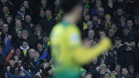 Jamal Lewis of Norwich celebrates victory with the home fans during the Premier League match against