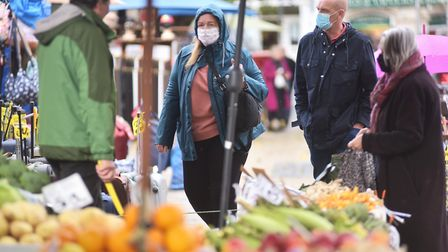 Shoppers at Norwich Market wearing face masks amid the coronavirus pandemic. Picture: Sonya Duncan