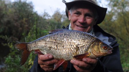 Pingers and his 2lb 2oz beauty Picture: John Bailey
