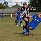 Joe Jackson, black and white, in action for his Saturday side Swaffham Town. Picture: Eddie Deane.