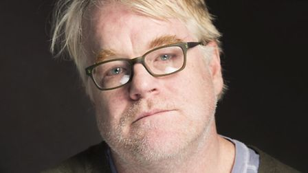 This photo taken Jan. 19, 2014, shows Phillip Seymour Hoffman posing for a portrait at The Collectiv