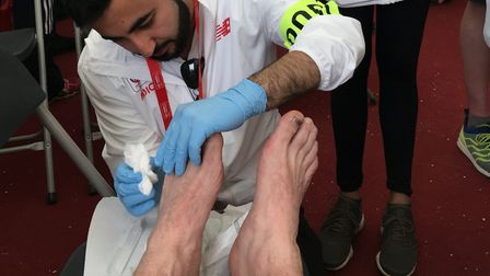 Nick's badly blistered feet being assessed by London Marathon medics after the 2018 event. Picture:
