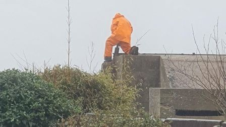 A worker using a jackhammer at the site of the former Second World War gun emplacement at Mundesley.