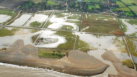 A breach in the clay bank at Salthouse following the December 5-6 storm surge is clearly shown in th