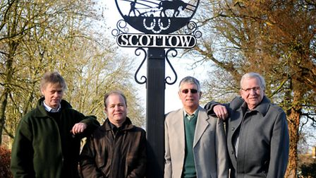 Scottow village sign. Left to right, Simon Shaw, Brendan Rallison, Mike Adams and Trevor Bunting.PHO
