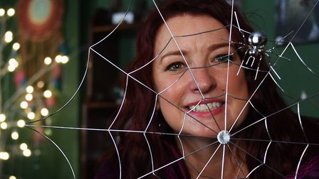 Samantha Wootton with a decorative spider's web in her newly opened Elementals Magickal Emporium at